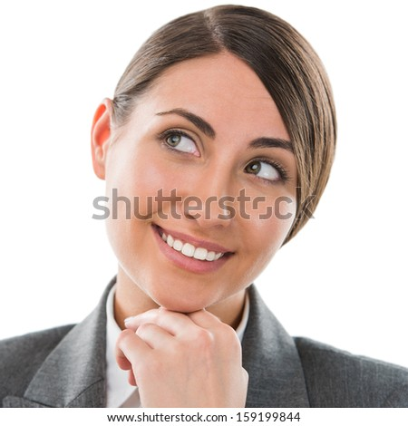Closeup portrait of beautiful woman thinking while smiling over white background - stock photo