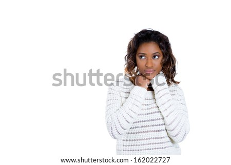 Closeup portrait of beautiful woman with fist on chin thinking about something that is making her sad looking to side, isolated on white background with copy space. Negative human emotions