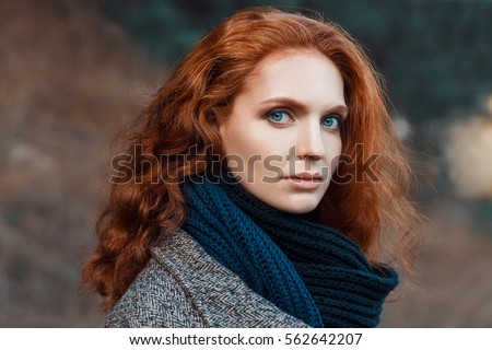 Girl with wavy brown hair and blue eyes