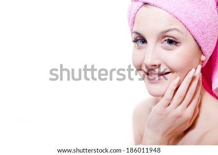 closeup portrait of beautiful young attractive girl blue eyes blond woman with pink towel happy smiling & looking at camera on white copy space background - stock photo