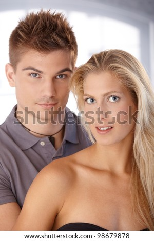 Closeup portrait of beautiful young couple looking at camera, smiling. - stock photo