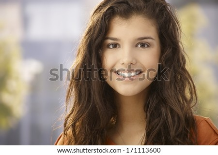 Closeup portrait of beautiful young girl smiling happy. - stock photo