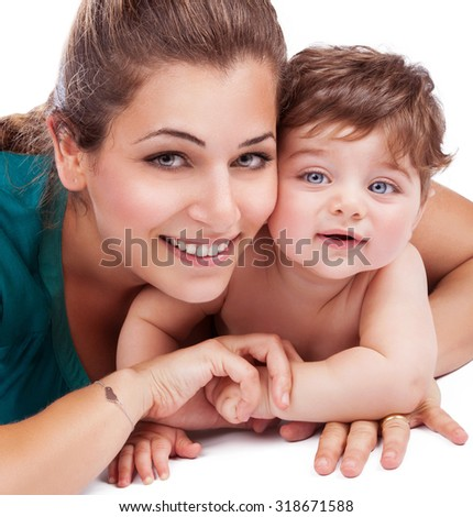 Closeup portrait of beautiful young mother with adorable baby son isolated on white background, lovely happy family