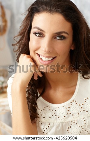 Closeup portrait of beautiful young smiling woman looking at camera. - stock photo