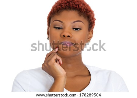 Closeup portrait of beautiful young woman, employee, thinking deeply about something, confused, deciding, plotting, looking downwards, isolated on white background. Negative emotion facial expressions - stock photo