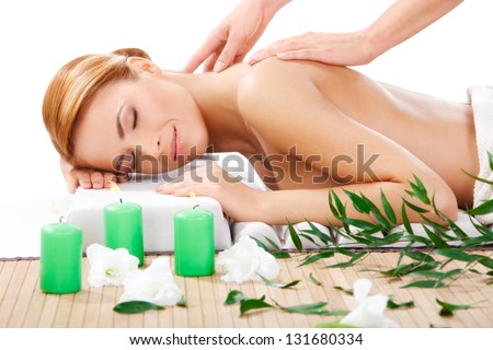 closeup portrait of beautiful young woman getting back massage at spa - stock photo