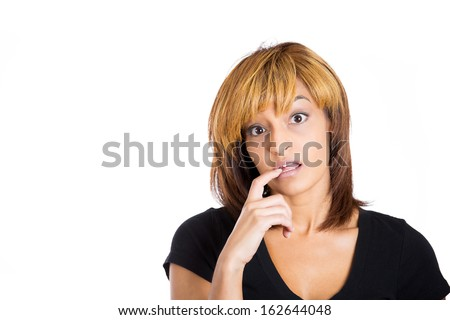 Closeup portrait of beautiful young woman looking at camera saying sorry I made a mistake by face and biting hand. Isolated on white background copy space to left. Negative emotions facial expression. - stock photo