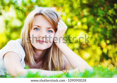 Closeup portrait of beautiful young woman smiling - Outdoor in summer green park - stock photo