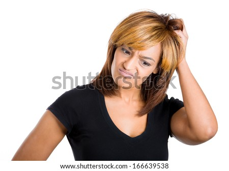 Closeup portrait of beautiful young woman thinking daydreaming deeply about something scratching head looking downwards, isolated on white background. Negative emotion facial expression feelings - stock photo