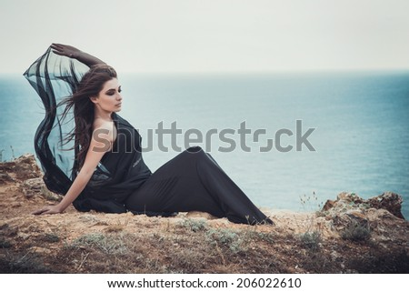 Closeup Portrait of beautiful young woman. Young active people. Outdoors.  Smoky eyes. Fashion colors. Cold sea