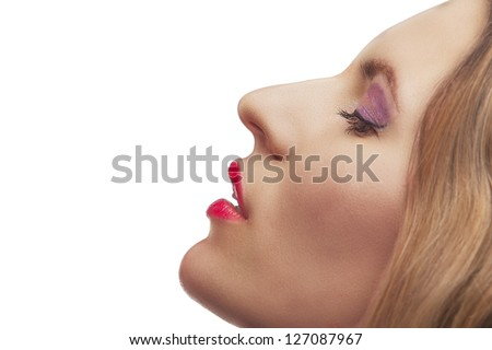 closeup portrait of blonde young woman with fashion makeup, profile view ,isolated on white