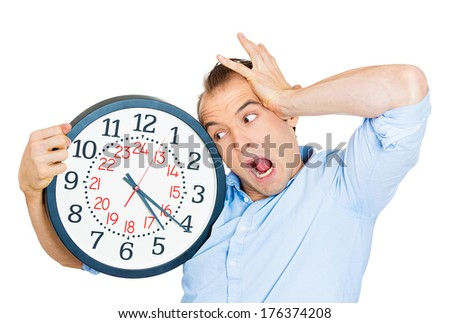 Closeup portrait of business man funny looking student holding clock stressed running out pressured by lack of time guy overwhelmed boy, late for meeting isolated on white background. Negative emotion
