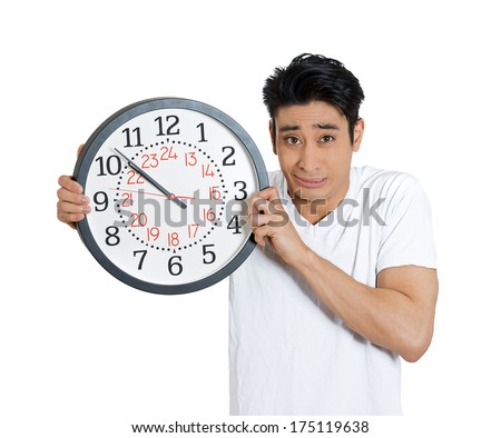 Closeup portrait of business man, funny student holding clock stressed, running out pressured by lack of time, trying to stop, hold it, late for meeting, isolated on white background. Negative emotion - stock photo