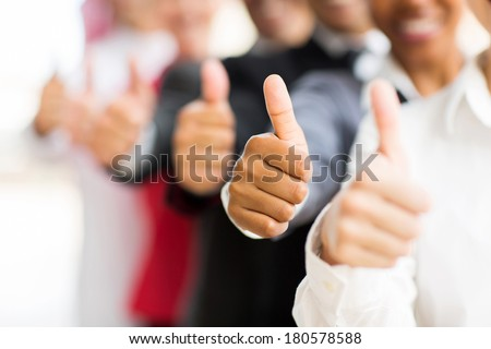 closeup portrait of business people giving thumbs up - stock photo
