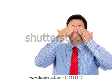 Closeup portrait of businessman covering his eyes with his hands not wanting to see something bad, isolated on white background with copy space - stock photo