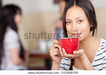 Closeup portrait of businesswoman drinking coffee in office cafe - stock photo