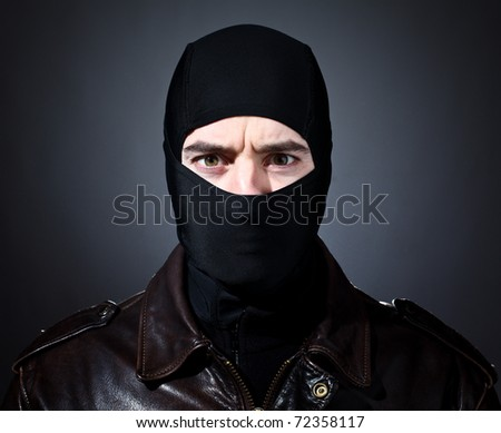 closeup portrait of caucasian criminal with balaclava
