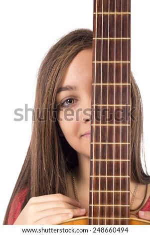 Closeup portrait of caucasian teenage girl with guitar over white background - stock photo