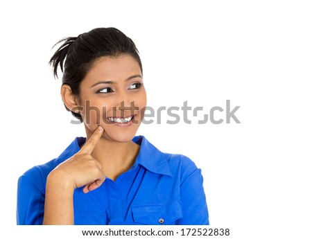 Closeup portrait of charming upbeat smiling joyful happy young woman looking upwards with finger on cheek daydreaming, isolated on white background. Positive human emotions facial expressions feelings - stock photo