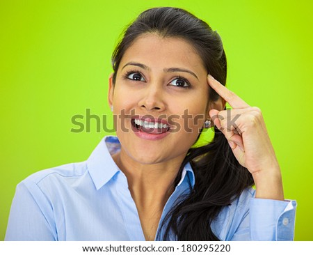 Closeup portrait of charming upbeat smiling joyful happy young woman looking upwards with finger on temple daydreaming, isolated on green background. Positive human emotions facial expression feelings - stock photo