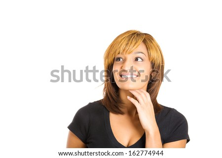 Closeup portrait of charming upbeat smiling joyful happy young woman looking upwards with hand on cheek daydreaming, isolated on white background copy space. Positive human emotions facial expressions - stock photo