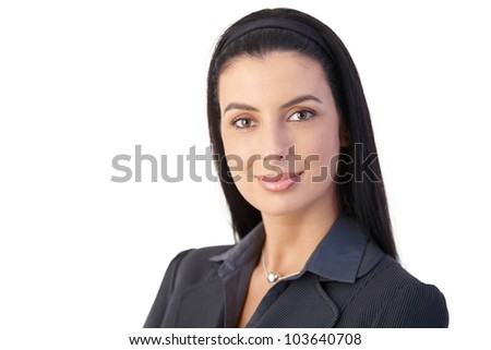 Closeup portrait of cheerful attractive businesswoman, smiling confidently. - stock photo