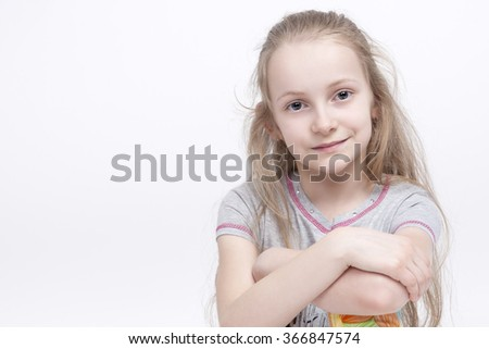 Closeup Portrait of Cheerful Smiling Caucasian Female Blond Kid with Hands Folded. Posing Against White Background. Horizontal Image - stock photo