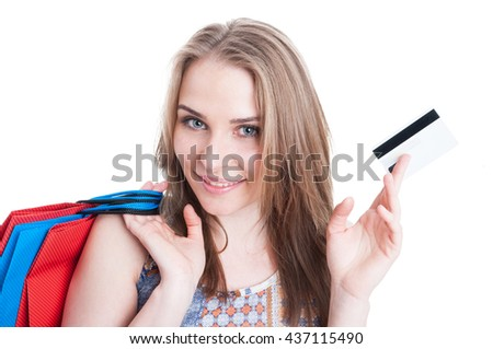 Closeup portrait of cheerful smiling shopper showing credit card and carrying shopping bags isolated on background - stock photo