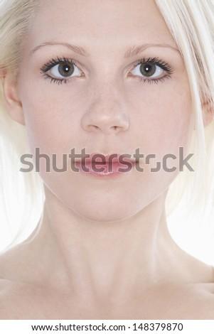 Closeup portrait of confident attractive woman against white background - stock photo