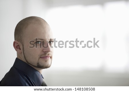 Closeup portrait of confident young businessman in warehouse - stock photo