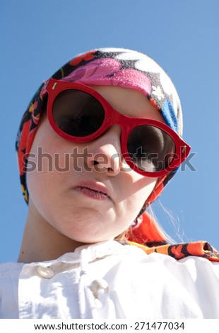 closeup portrait of cool young girl in bandana and big sunglasses - stock photo