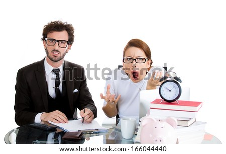 Closeup portrait of couple, handsome man, beautiful woman, looking distressed from financial problems, mounting bills, tax preparation, isolated on white background. Bad finance decision. Bank mistake - stock photo