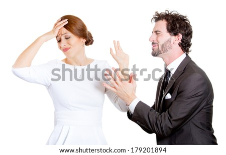 Closeup portrait of couple, man woman. Sad husband on his knees asking, begging for forgiveness wife who is reluctant to accept apology, isolated on white background. Human emotions, face expressions - stock photo