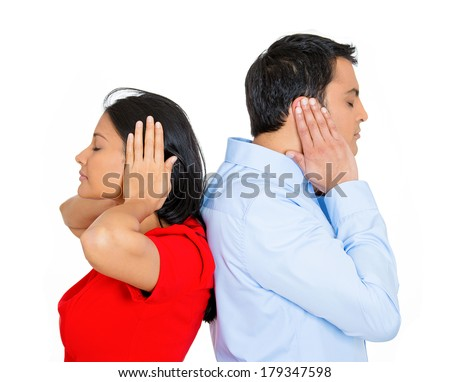 Closeup portrait of couple, man, woman standing with backs together, covering ears, closed eyes, not listening to each other isolated on white background. Negative human emotions, facial expressions - stock photo