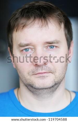 Closeup portrait of courageous middle age man - stock photo