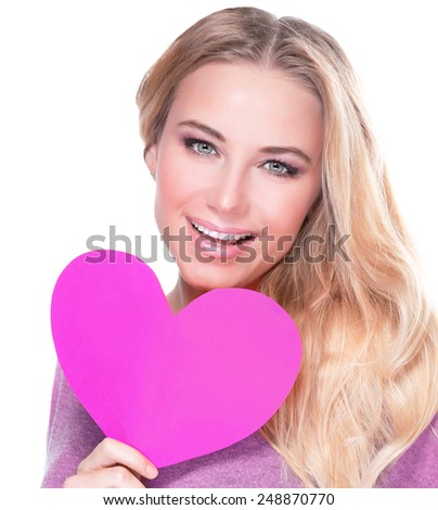 Closeup portrait of cute cheerful female with big paper heart in hands isolated on white background, healthy lifestyle, happy Valentine day concept - stock photo