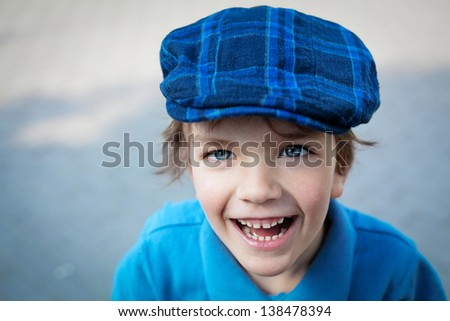Closeup portrait of cute little boy laughing - stock photo