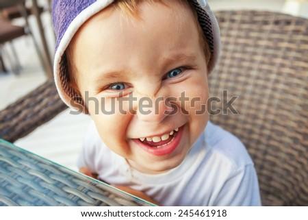 Closeup portrait of cute little funny boy - stock photo