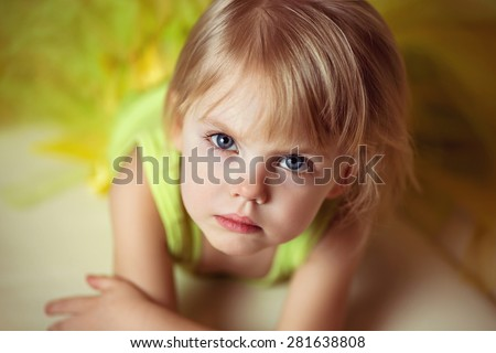 closeup portrait of cute little girl with a serious face - stock photo