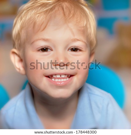 Closeup portrait of cute little smiling boy, have fun, healthy teeth, happy childhood, adorable child with sweet smile - stock photo