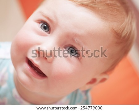 Closeup portrait of cute sad baby, upset little child with tears on eyes, innocent small girl weeping, unhappy childhood or hungry kid concept - stock photo