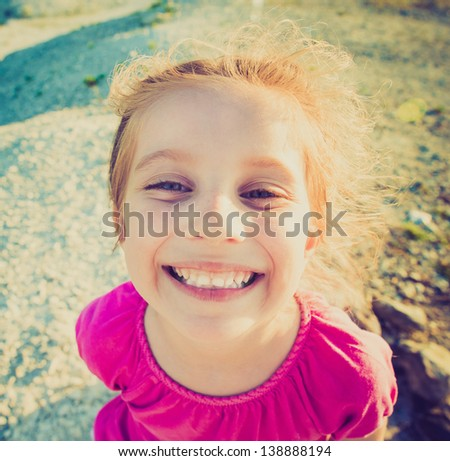 closeup portrait of cute smiling girl - stock photo