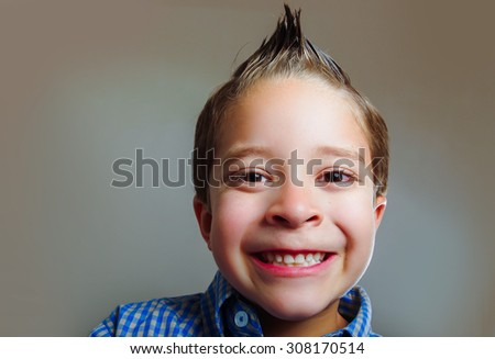 Closeup portrait of cute young boy looking happy - stock photo