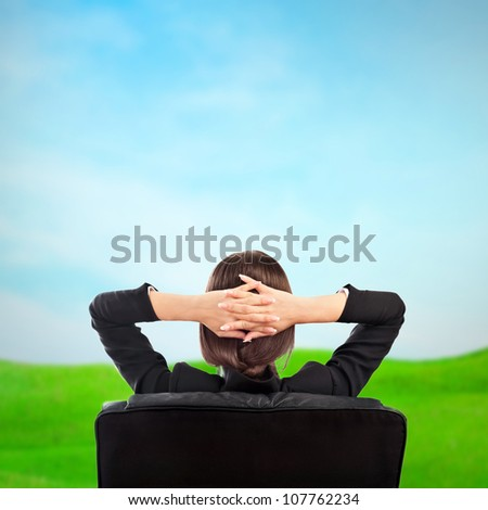 Closeup portrait of cute young business woman from behind dreaming, resting and imagine idyllic view - stock photo