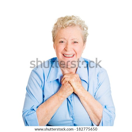 Closeup portrait of desperate senior mature woman showing clasped hands, pretty please with sugar on top, isolated on white background. Positive emotion facial expression feelings, body language.