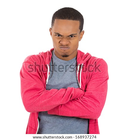 Closeup portrait of displeased pissed off angry grumpy man in red hoodie with bad attitude, arms crossed looking at you, isolated on white background . Negative human emotion facial expression feeling - stock photo
