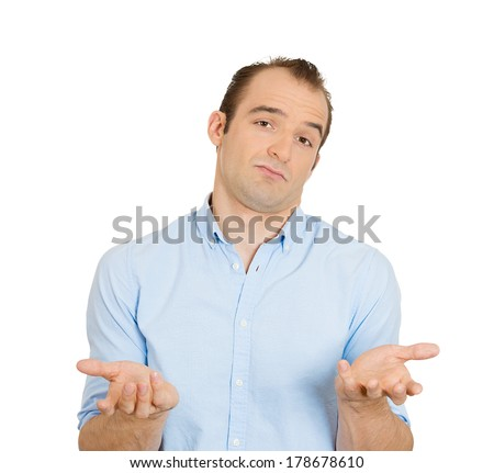 Closeup portrait of dumb clueless funny looking young man, arms out asking what's the problem who cares so what, I don't know, isolated on white background. Negative human emotions, facial expressions