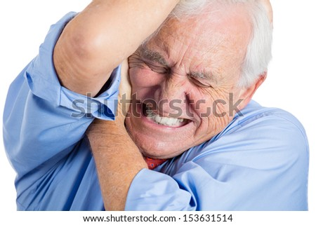 Closeup portrait of elderly, senior, mature man in great excruciating pain,   isolated on white background - stock photo