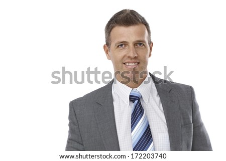 Closeup portrait of elegant businessman in suit and tie smiling happy.