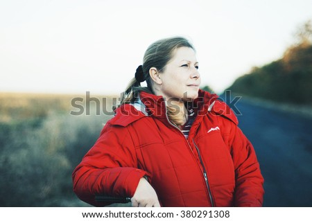 Closeup portrait of elegant middle aged woman.  Portrait of a young woman. Cute middle aged woman portrait on nature. Middle age woman with  close up portrait on nature background. - stock photo